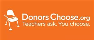 DonorsChoose.org Teachers ask. You Choose.  White Lettering against orange background and white desk image.