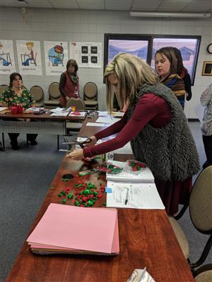 LCS Preschool Teachers Participate in a Make and Take Training