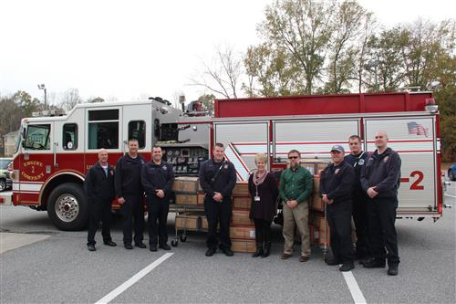 Lincolnton Fire Fighters Give Coats to Local Students