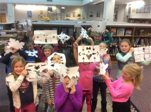 Students from Mrs. Whitley's Class pose with their snowflakes