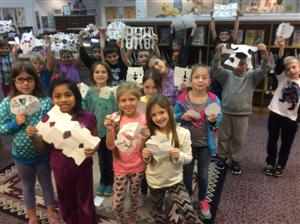 Mrs. Reynold's class with their snowflake creations